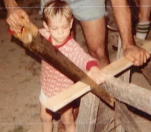 May 82 Joe sawing with dad